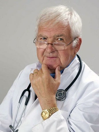 Doctor in a white gown with a stethoscope around his neck.