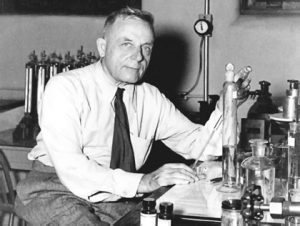 Black and white photo with Dr. Otto Warburg in laboratory.