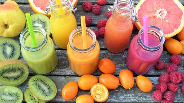 photo of liquid smoothies with kiwi, oranges, pear and raspberry.